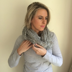 Tuck in any loose end of the scarf